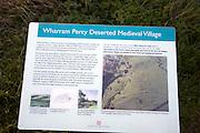 Information board medieval deserted village, Wharram Percy, Yorkshire, England