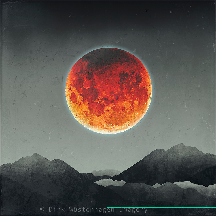 Big red moon over silhouetted mountains - photo illustration