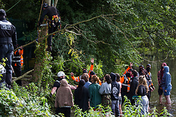 Denham, UK. 7th September, 2020. A large branch cut from a tree by a tree surgeon working on behalf of HS2 Ltd is lowered towards security workers and HS2 Rebellion activists taking direct action to prevent or delay tree felling works in conjunction with the HS2 high-speed rail link in Denham Country Park. Anti-HS2 activists continue to campaign and take direct action against the controversial £106bn project for which the construction phase was announced on 4th September from a series of protection camps based along the route of the line between London and Birmingham.