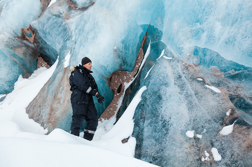 Glaciologist Poul Christoffersen inspects exposed ice on the tidewater terminus of Tunabreen, Svalbard.