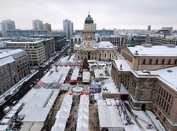 View of annual Christmas market at Gendarmenmarkt in Mitte Berlin Germany