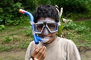 Ecuador, May 10 2010: Chino's son shows off his new scuba gear. Copyright 2010 Peter Horrell