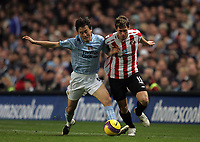 Photo: Paul Thomas/Sportsbeat Images.<br /> Manchester City v Sunderland. The FA Barclays Premiership. 05/11/2007.<br /> <br /> Jihai Sun (L) tackles Sunderland's Daryl Murphy.