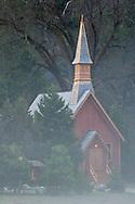Misty morning fog shrouds the Valley Chapel in spring, Yosemite Valley, Yosemite National Park, California
