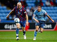 Football<br /> Shaun Derry of Crystal Palace Jack Cork of Coventry City (on loan from Chelsea)<br /> Coca-Cola Championship<br /> Coventry City v Crystal Palace at Ricoh Arena<br /> 21/11/2009 Credit Colorsport / Kieran Galvin