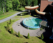 Three men relax in a heated swimming pool in the summer at Spa Hotel Rauhalahti, Kuopio, Central Finland.