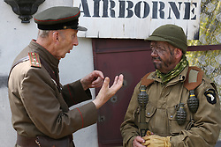 © Licensed to London News Pictures. 27/04/2018. Denmead, UK. Participants, dressed as an American soldier from the 101st Airbourne Division (R) and a Russian officer, take part in the Overlord Military Spectacular, a gathering of military re-enactors. The event, 1st held in 1977, is organised by The Solent Overlord Military Collectors Club and features some 200 military vehicles and 500 re-enactors dressed in authentic uniforms and equipment from the era.   Photo credit: Julian Herbert/LNP
