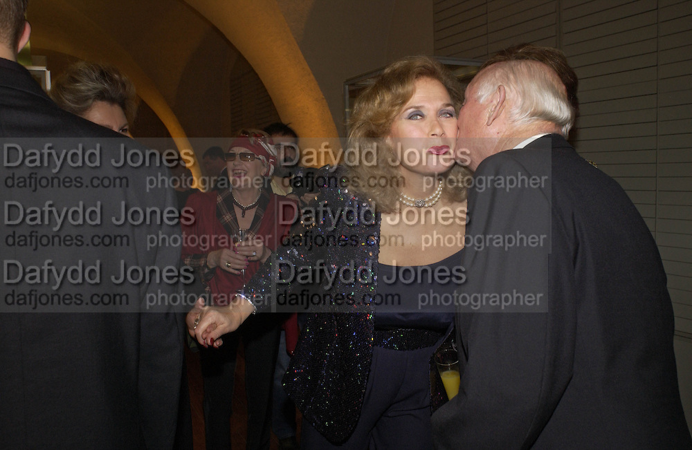 Valerie Leon and Lord Montagu, Opening of Hungary's Heritage-Princely Treasures from the Esterhaxy Collection. The Gilbert collection. Somerset House. 25 October 2004. ONE TIME USE ONLY - DO NOT ARCHIVE  © Copyright Photograph by Dafydd Jones 66 Stockwell Park Rd. London SW9 0DA Tel 020 7733 0108 www.dafjones.com