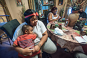 MILWAUKEE, WI -- 8/11/15 -- Sandra Fitzgerald, 20, holds her son, <br /> Caydinn Fitzgerald, 2, as Caryolyn Williams speaks with activist Tory Lowe. Caydinn's father, Gregory Rollins was shot by police as he ran from a detective. He is currently in jail on a murder charge. Milwaukee leads the nation in most negative indicators of African-American social problems: educational achievement gaps, incarceration rates, unemployment and segregation. This year Milwaukee has already seen more than double the number of homicides than all of 2014. The 52306 zip code is ground zero: 62% of all men have served time in a correctional facility by age 34. and the homicide rate is nearly three times greater than the rest of the city…by André Chung #_AC26463