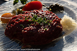 Outdoor dining on delicious steak tartare after the Art and Wheels art and motorcycle show, Basel, Switzerland. May 18, 2015. Photography ©2015 Michael Lichter.