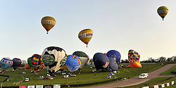 ©London News pictures. 07/04/2011. CANTERBURY: Approximately 50 hot air balloons from across the UK and Europe take off from Lydden Hill Race Circuit, Wootton, Kent to fly across the English Channel marking the largest ever group of balloons to attempt the crossing.. Picture credit should read Stephen Simpson/LNP
