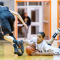 Gallup Bengal Quincy Smith (20), right, swipes a ball from Aztec Tiger Jake Feil (2) at Gallup High School Friday.
