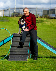 Pictured: <br />Scottish Liberal Democrat Leader Willie Rennie headed to Edinburgh's Cat and Dog home today for a tour before criticising the SNP 's record in Government. Daisy the English Bull Terrier took Mr Rennie for some exercise<br />Ger Harley | EEm 23 April 2021