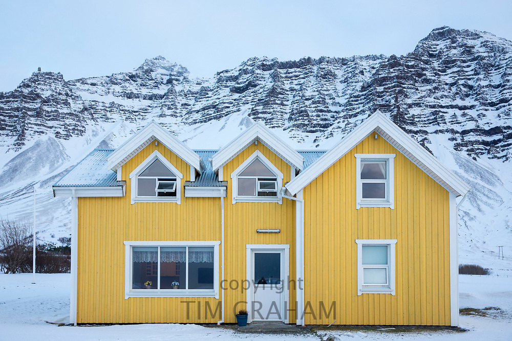Traditional typical bright yellow colour Icelandic corrugated iron dwelling at Hali Country Hotel, near Hofn, South Iceland