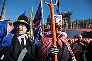 Peoples Vote supporter as Jacob Rees Mogg with the devil as Anti Brexit pro Europe demonstrators protest in Westminster opposite Parliament as MPs debate and vote on amendments to the withdrawal agreement plans on 14th February 2019 in London, England, United Kingdom.
