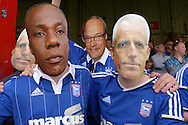 some Ipswich Town fans wear carboard face masks of Terry Connor, the Ipswich Town assistant manager (l), Gregg Wallace, the Masterchef host © and Mick McCarthy, the Ipswich Town manager (r) before k/o. Skybet football league Championship match, Brentford v Ipswich Town at Griffin Park in London on Saturday 8th August 2015.<br /> pic by John Patrick Fletcher, Andrew Orchard sports photography.