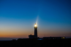 © Licensed to London News Pictures. 22/12/2016. Flamborough Head UK. The light house at Flamborough Head in Yorkshire operating at Dawn this morning as coastal towns prepare for the arrival of storm Barbara. Photo credit: Andrew McCaren/LNP