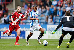 Lee Peltier of Huddersfield is challenged by Adam Clayton of Middlesbrough  - Photo mandatory by-line: Rogan Thomson/JMP - 07966 386802 - 13/09/2014 - SPORT - FOOTBALL - Huddersfield, England - The John Smith's Stadium - Huddersfield town v Middlesbrough - Sky Bet Championship.