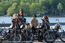 Iron Lilies (left to right) Dana Cooley, Lilly James, Leticia Cline and Kissa Von Addams out riding during Laconia Motorcycle Week 2016. NH, USA. Sunday, June 19, 2016.  Photography ©2016 Michael Lichter.