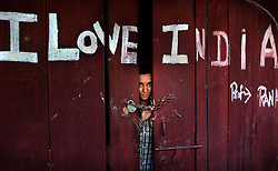 An Indian boy stands inside a shop near Ahknoor in the Indian held state of Jammu and Kashmir, May 29, 2002. Indian and Pakistani troops continue to exchange heavy mortar, artillery and machine-gun fire along the line that divides Kashmir between them. India is pressing Pakistani President Pervez Musharraf to crack down on the flow of Muslim militants from Pakistan into Kashmir.