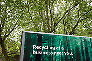 Side view of a recycling van amongst trees in London, England, United Kingdom.