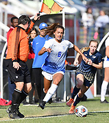 The linesman calls the ball out of bounds as St. Louis University defender Sophia Denison (left) and George Washington defender Hannah Zaluski chase after it. St. Louis University defeated George Washington in the championship game of the Atlantic 10 Conference Women's Soccer Tournament at Robert Hermann Stadium at St. Louis University on Sunday November 10, 2019.<br /> Photon by Tim Vizer