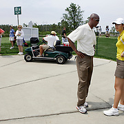 Mt. PLEASANT, SC, May 31, 2007:  Michelle Wie talks with her agent Greg Nared moments before she withdrew from the Ginn Tribute Hosted by Annika Sorrenstam in Mt. Pleasant, South Carolina on May 31, 2007. Wie was two shots away from shooting a 88 which would have prohibited her from playing in any other LPGA tournaments in 2007. (Photo by Todd Bigelow/Aurora)