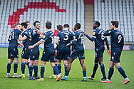 GOAL 1-2 Morecambe forward Cole Stockton (9) scores and celebrates with Morecambe defender Stephen Hendrie (3), Morecambe midfielder Toumani Diagouraga (8) and Morecambe Forward Carlos Mendes Gomes (11), Morecambe defender Ryan Cooney (21) and Morecambe defender Harry Davis (6)  during the EFL Sky Bet League 2 match between Stevenage and Morecambe at the Lamex Stadium, Stevenage, England on 6 February 2021.