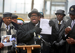 02 March 2010. New Orleans, Louisiana, USA. <br /> Civil Rights leaders gather at the notorious Danziger Bridge in New Orleans East, scene of the Sunday Sept 4th, 2005 murder of 40 yr old Ronald Madison and 19 yr old James Brissette by New Orleans police. <br /> Reverend Raymond Brown addresses the media.<br /> The police are under federal investigation for an alleged cover up of the botched killings in the chaotic aftermath of hurricane Katrina. <br /> Photo; Charlie Varley.