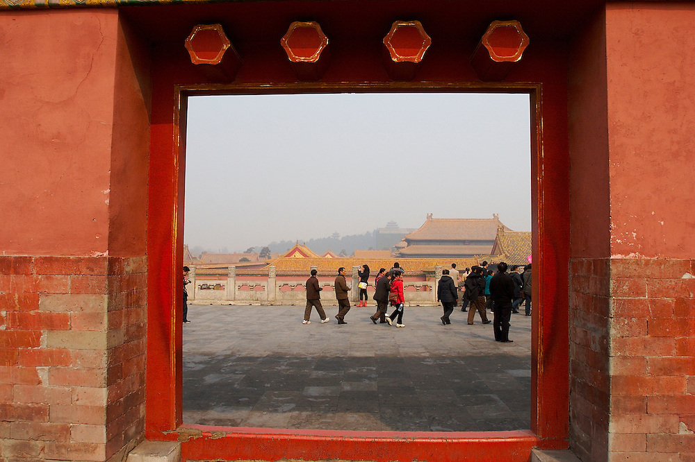 A doorway inside the Forbidden City Beijing, China. Gu Gong, called The Forbidden City in English, is located in the center of Beijing.  It was once the imperial palace for the Ming and Qing Dynasties and is just shy of 183 acres.
