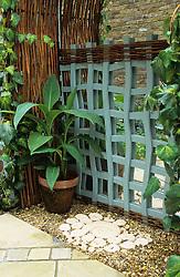 Wobbly trellis 'gate'  in front of mirror to suggest garden beyond