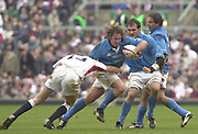 Photo - Peter Spurrier<br /> 09/03/2003 <br /> RBS Six Nations International Rugby -  England v Italy's Aaron Percico moves past the tackle from Will Greenwood,