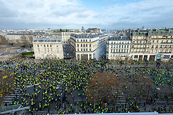 """Yellow Vests"" protesters confront police near the Arch of Triumph in Paris, France, on December 8, 2018. Riot police fired tear gas and water cannon at ""Yellow Vests"" protesters marching in Paris, France, on Saturday in the fourth week-end action despite President Emmanuel Macron's series of concessions. Photo by Serge Tenani/Avenir Pictures/ABACAPRESS.COM"