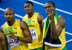 Asafa Powell, Steve Mullings and Usain Bolt  of Jamaica celebrate winning the gold medal in the mens 4x100 Metres Relay Final with mascot Berlino during day eight of the 12th IAAF World Athletics Championships at the Olympic Stadium on August 22, 2009 in Berlin, Germany. (Photo by Vid Ponikvar / Sportida)