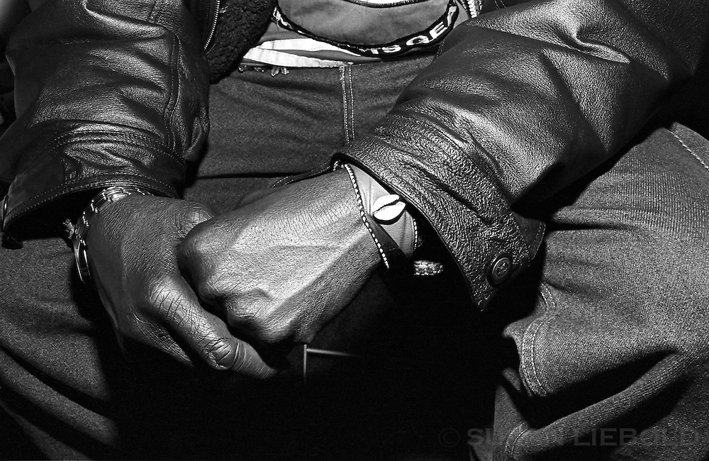 Malian man wearing cowry shell bracelet.