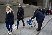 A man struggling to put up a folding seat. The Lord Mayor's Show, one of the longest-established annual events, dating back to the 16th century. Held within the City of London, UK.