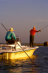 Stock photo of two men in a boat fly fishing in the South Texas Gulf