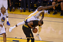 The Golden State Warriors' Draymond Green lands on the Cleveland Cavaliers' Tristan Thompson during the second quarter of Game 5 of the NBA Finals at Oracle Arena in Oakland, Calif., on Monday, June 12, 2017. (Photo by Jose Carlos Fajardo/Bay Area News Group/TNS) *** Please Use Credit from Credit Field ***