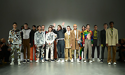 Alex Mullins (with raised hands) with models during the Alex Mullins London Fashion Week Men's AW18 show held at BFC Show Space, London.
