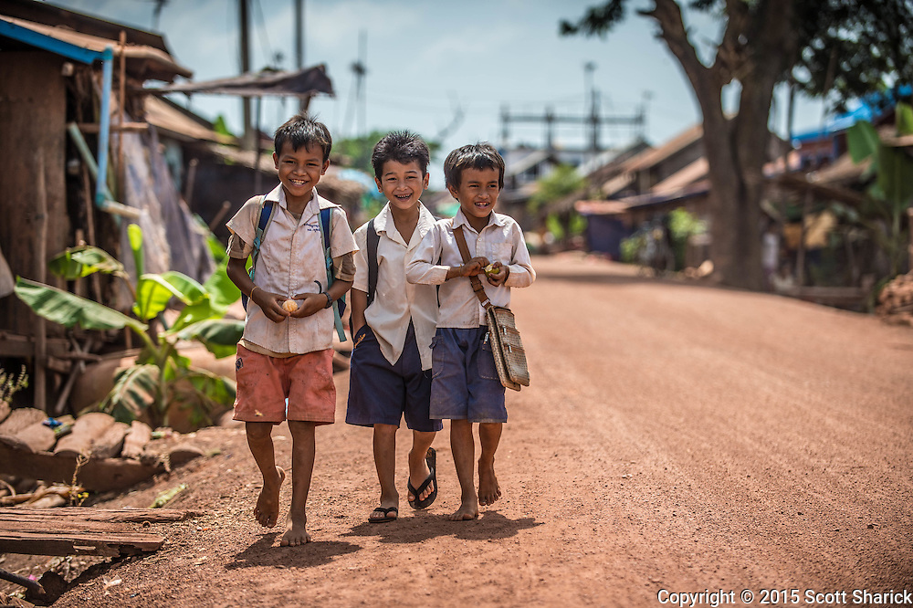 Boys walk along the street in Kompong Khleang, Cambodia. This is one of the floating villages along the Tonle Sap.