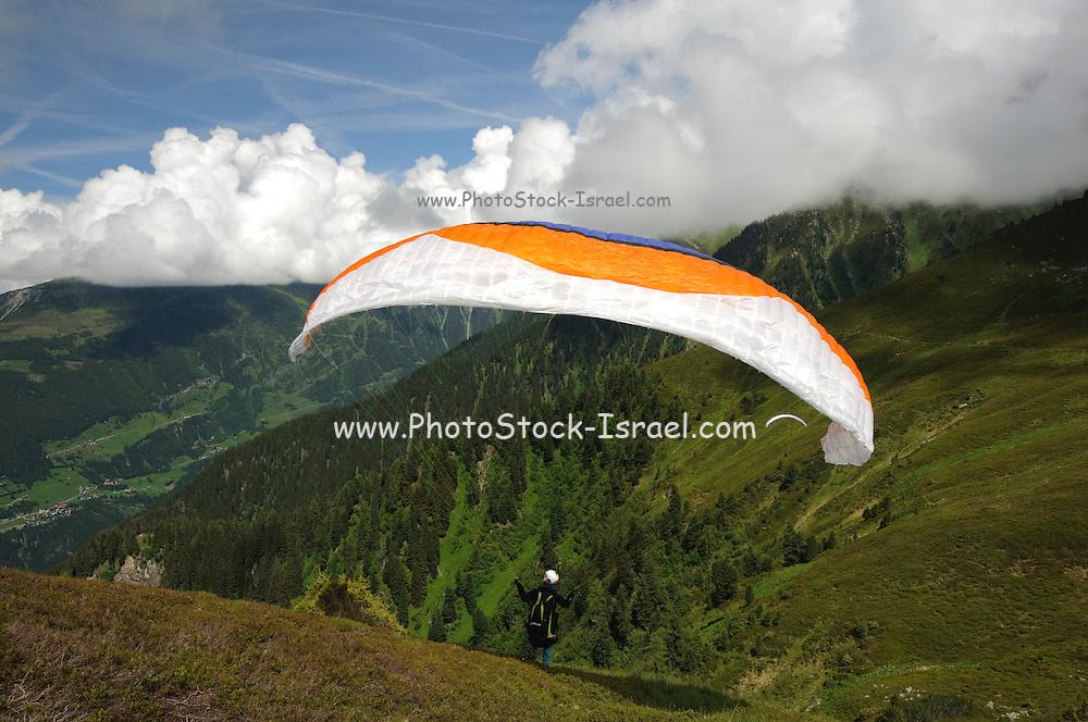 Zillertal, Tyrol, Austria Parachuting off the cliff