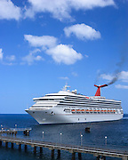 Carnival Destiny Cruise Ship docking in Roseau, Dominica <br /> <br /> Editions:- Open Edition Print / Stock Image