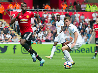 Football - 2017 / 2018 Premier League - Swansea City vs. Manchester United<br /> <br /> Paul Pogba of Manchester United attacks—<br /> , at Liberty Stadium.<br /> <br /> COLORSPORT/WINSTON BYNORTH
