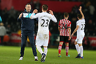 Swansea city manager Paul Clement celebrates with goal scorer Gylfi Sigurdsson of Swansea city at the end of the game after they win 2-1. Premier league match, Swansea city v Southampton at the Liberty Stadium in Swansea, South Wales on Tuesday 31st January 2017.<br /> pic by  Andrew Orchard,