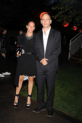 Artist DINOS CHAPMAN and his wife TIPHAINE at the annual Serpentine Gallery Summer Party in Kensington Gardens, London on 9th September 2008.
