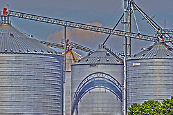 30 July 2012:  Hudson Grain Coop grain storage and processing facility in the town of Hudson in McLean County of Illinois..This image was produced in part utilizing High Dynamic Range (HDR) processes.  It should not be used editorially without being listed as an illustration or with a disclaimer.  It may or may not be an accurate representation of the scene as originally photographed and the finished image is the creation of the photographer.
