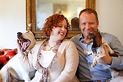 Lisa and Jason Druebert sit for a portrait with their dogs Pup, left, and Schnitzel in their Dallas home on December 4, 2012.  (Stan Olszewski/The Dallas Morning News)
