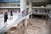 Excavations of ancient ruins outside the modern Acropolis Museum. The Acropolis Museum is an archaeological museum focused on the findings of the archaeological site of the Acropolis of Athens. The museum was built to house every artifact found on the rock and on its feet, from the Greek Bronze Age to Roman and Byzantine Greece. It also lies on the archaeological site of Makrygianni and the ruins of a part of Roman and early Byzantine Athens. The museum was founded in 2003, while the Organisation of the Museum was established in 2008. It opened to the public on June 21, 2009. Nearly 4,000 objects are exhibited over an area of 14,000 square metres. Athens is the capital and largest city of Greece. It dominates the Attica periphery and is one of the world's oldest cities, as its recorded history spans around 3,400 years. Classical Athens was a powerful city-state. A centre for the arts, learning and philosophy.