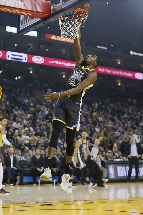 Golden State Warriors forward Kevin Durant (35) dunks against the Los Angeles Lakers in the first half of an NBA game at Oracle Arena on Saturday, Feb. 2, 2019, in Oakland, Calif.