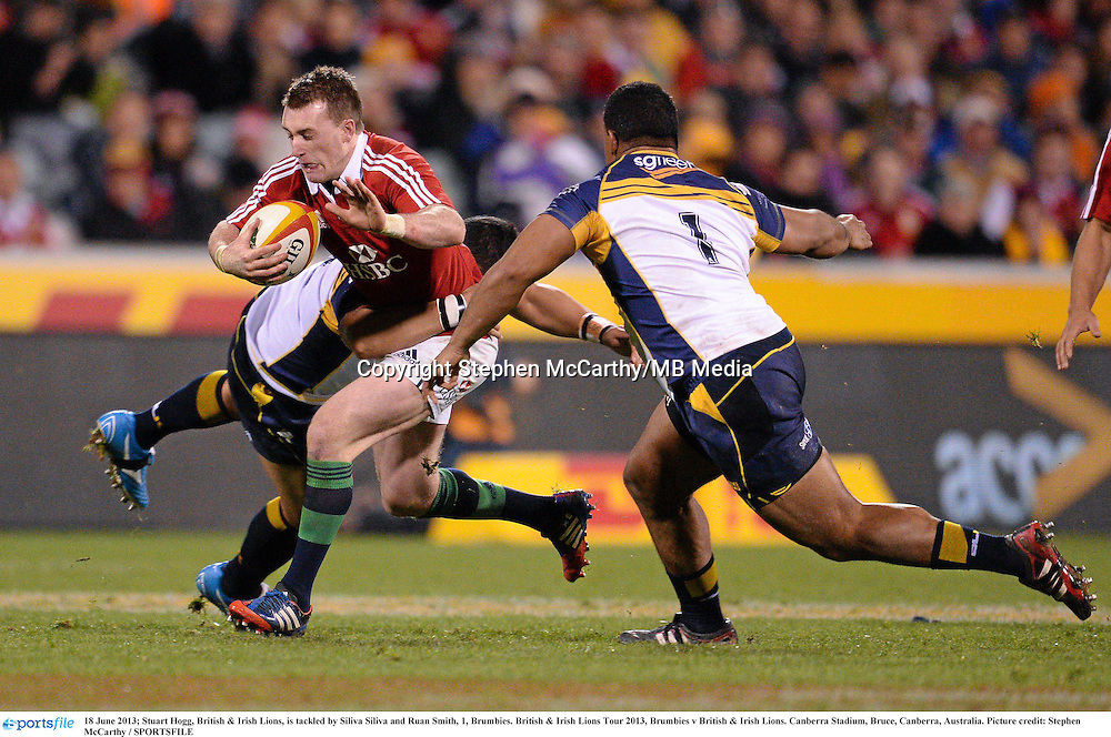 18 June 2013; Stuart Hogg, British & Irish Lions, is tackled by Siliva Siliva and Ruan Smith, 1, Brumbies. British & Irish Lions Tour 2013, Brumbies v British & Irish Lions. Canberra Stadium, Bruce, Canberra, Australia. Picture credit: Stephen McCarthy / SPORTSFILE